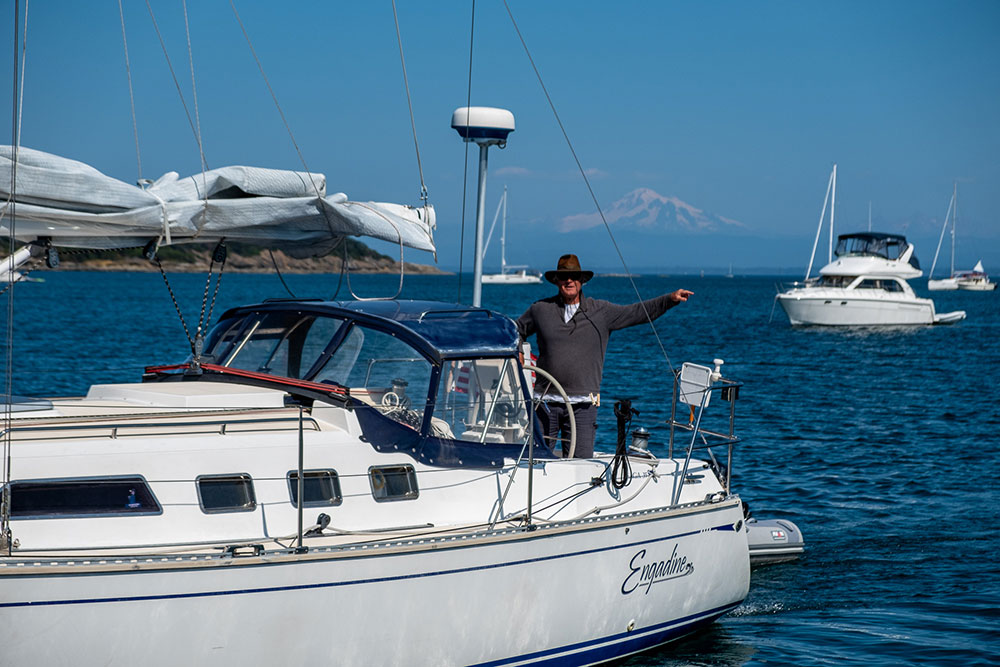 Peter on the Saga 35, Engadine, finding his desired anchoring spot in Echo Bay on Sucia Island.