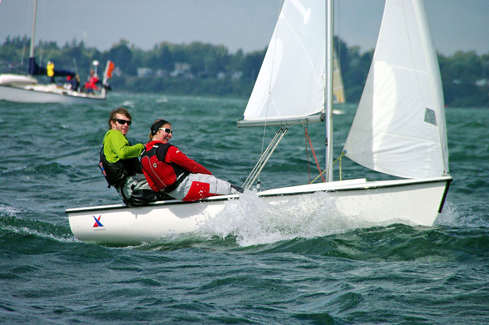 Sarah with her friend and skipper Pete McGrath, sailing on Bellingham Bay for Western Washington University.
