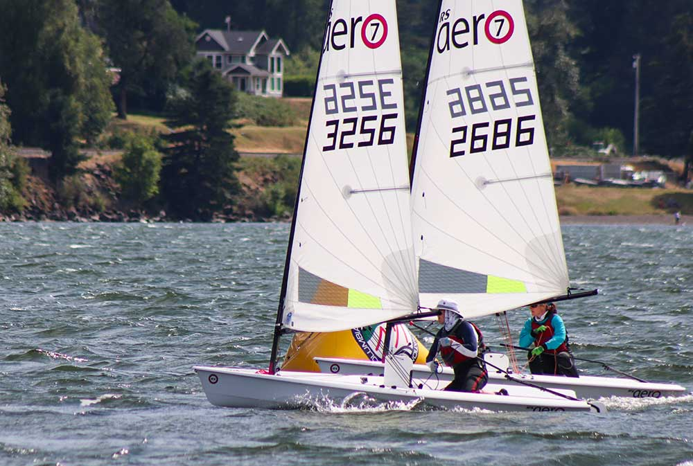 Tight racing indeed. Author, Jen Morgan Glass, gets inside rounding rights at a mark.