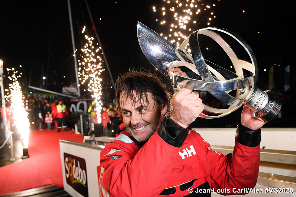 Bestaven hoists the coveted Vendée trophy after redress given made him the overall winner.