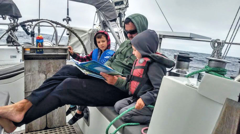 Andy and his boys, Porter and Magnus, on passage from Alaska to San Francisco.