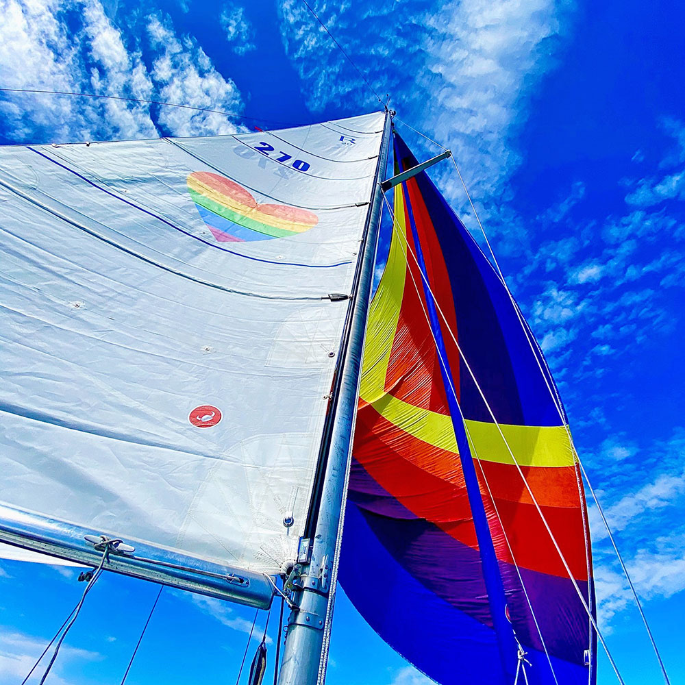 Jenn Harkness has rainbow sails on her Ranger 29, Poop Deck. Love is love. Love wins.