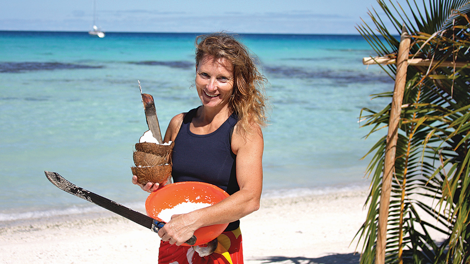 Amanda with the tools of the cocnut trade on Mopelia.